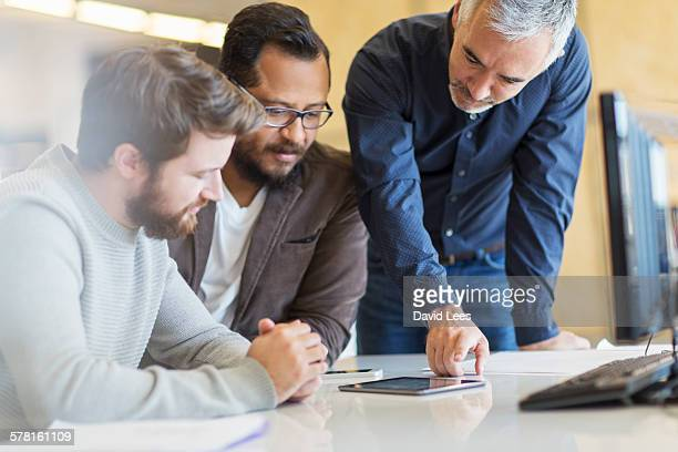 Businessmen having meeting in conference room