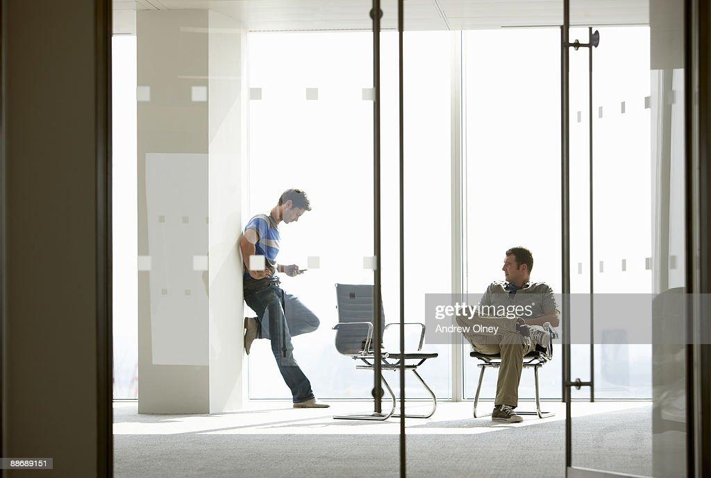 Businessmen having meeting in empty office : Stock Photo