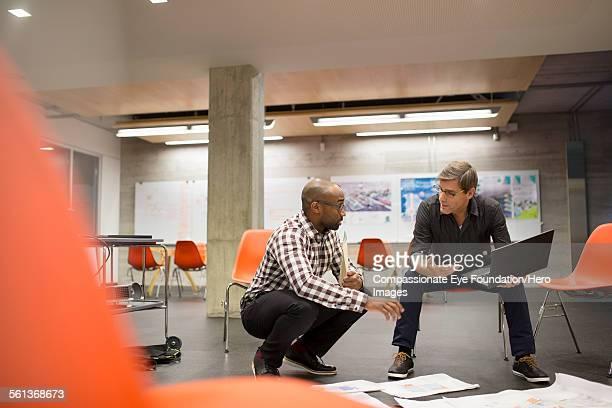 Businessmen having meeting in office