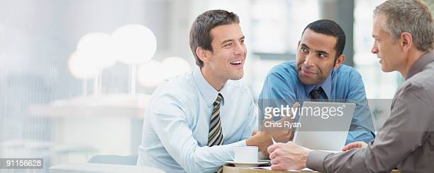 businessmen having meeting in office - persuasion stock pictures, royalty-free photos & images