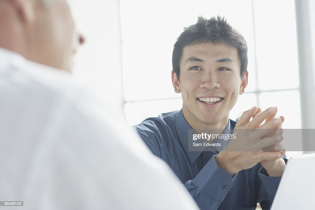 Businessmen having meeting : Stock Photo