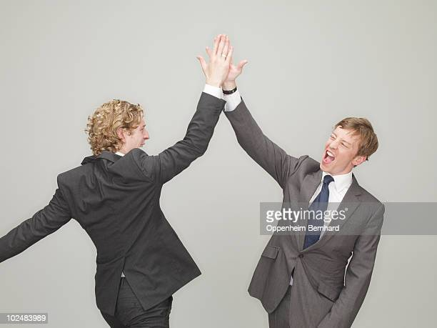 businessmen high fiving - high five stock pictures, royalty-free photos & images