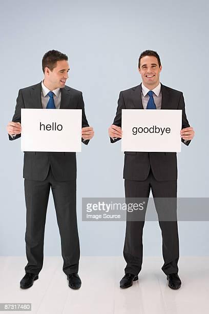 Businessmen holding signs