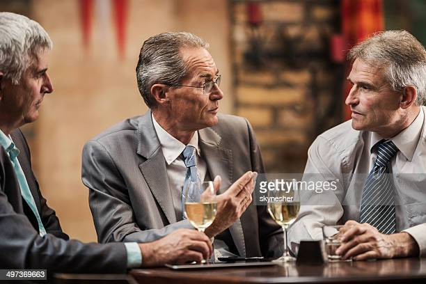 Businessmen in a bar.