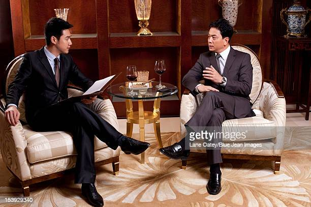 Businessmen in a meeting in a luxurious room