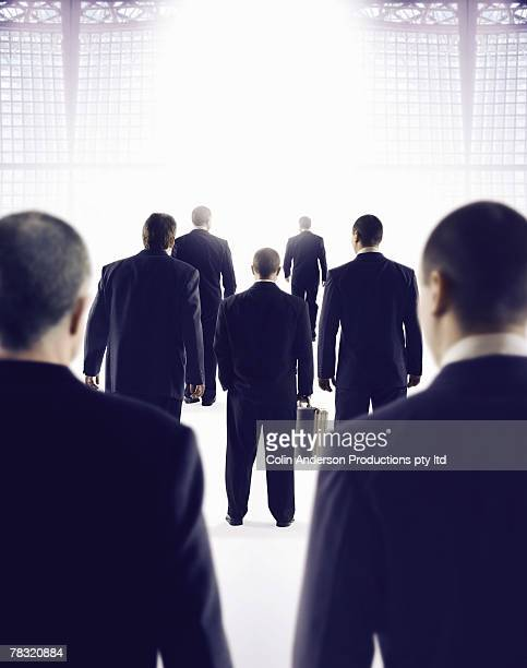 Businessmen in bright light