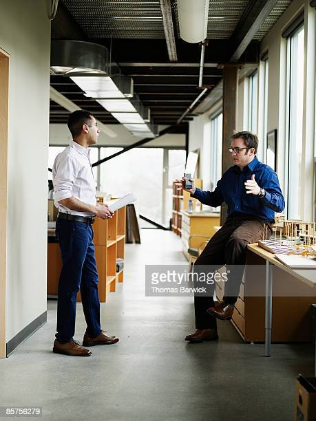 businessmen in discussion in office - american influenced stock photos and pictures