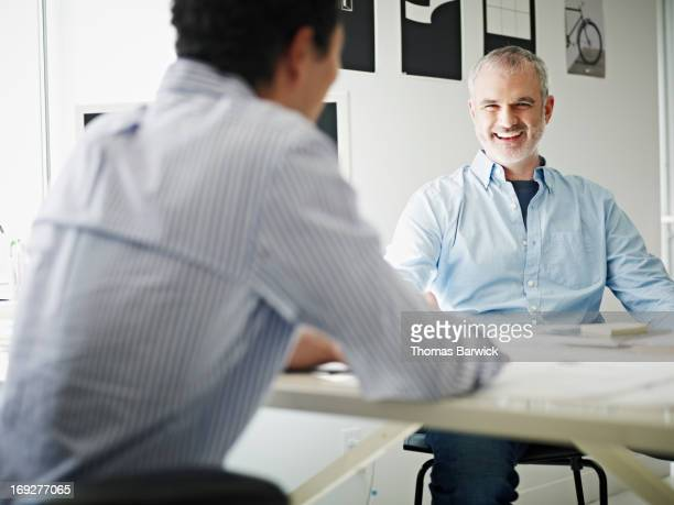 Businessmen in discussion in startup office