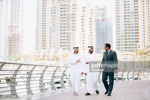 Businessmen in Dubai making business