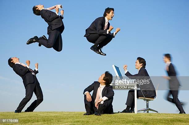 Businessmen in field, digital composite