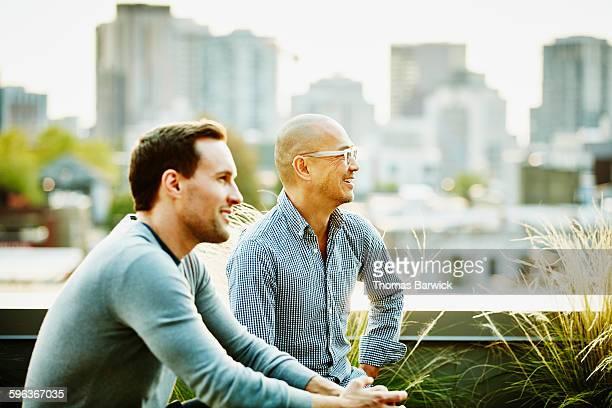 Businessmen in informal meeting on office terrace
