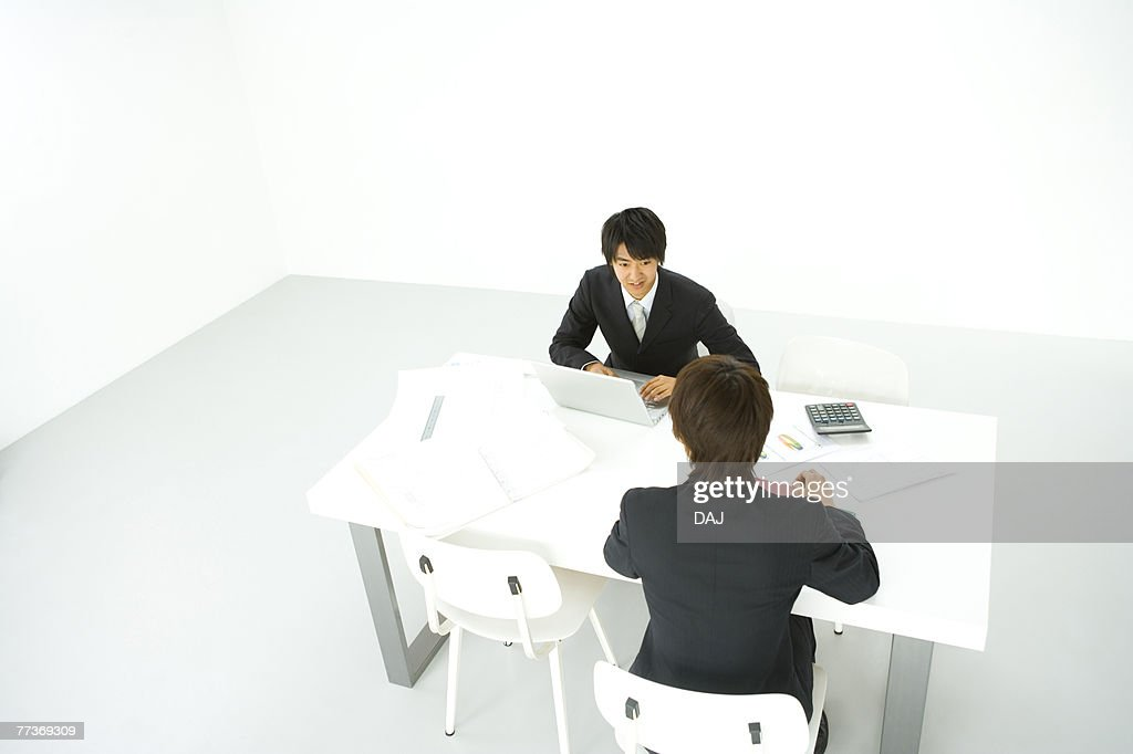 Businessmen In Meeting, High Angle View : Photo