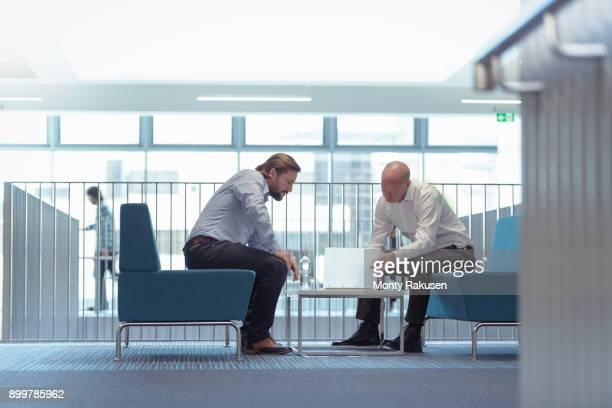 Businessmen in meeting in railway engineering facility