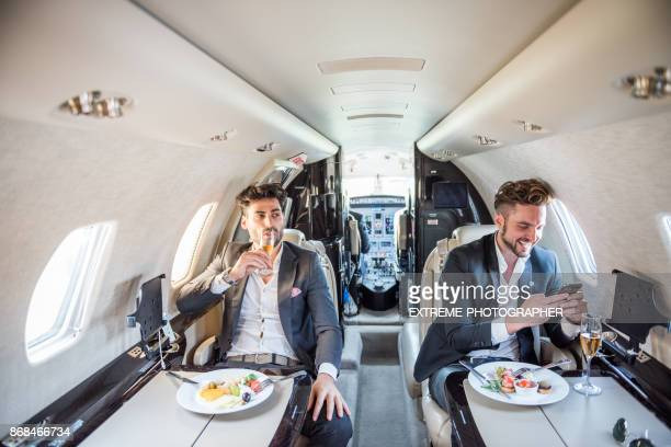 Businessmen in private jet airplane
