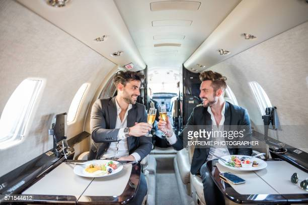 Businessmen in private jet airplane