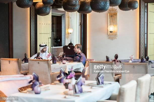 businessmen in restaurant. - ras al khaimah stock pictures, royalty-free photos & images