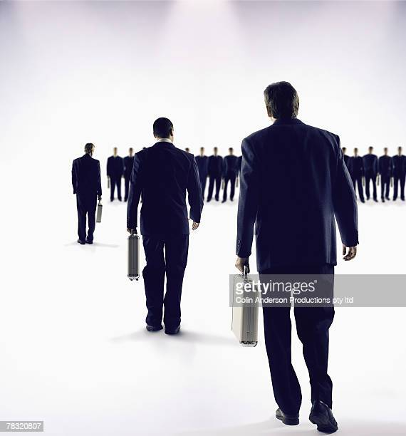 Businessmen in single file line