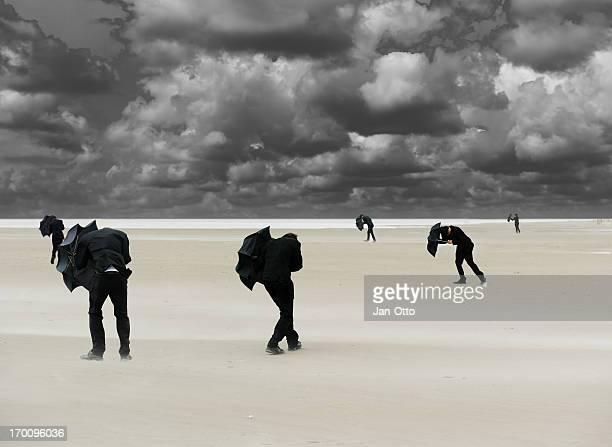 Businessmen in stormy weather