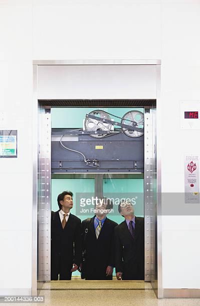 Businessmen in stuck elevator