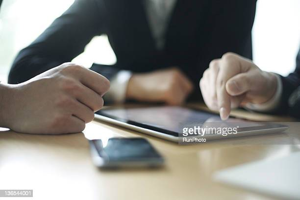 businessmen in the office,touching digital tablet