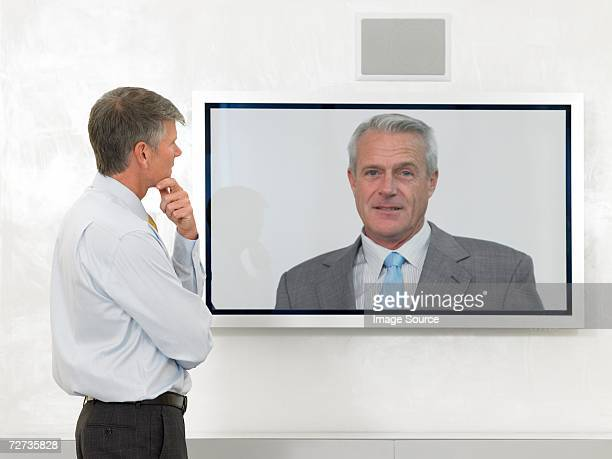 businessmen in video conference - mindzoom 2 stock pictures, royalty-free photos & images