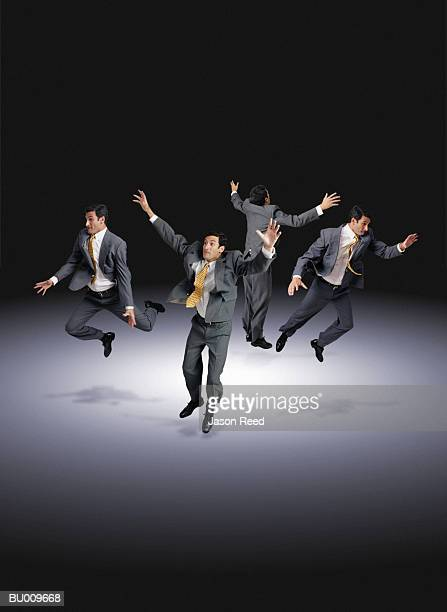 Businessmen Jumping in All Directions