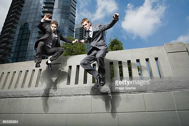 Businessmen jumping