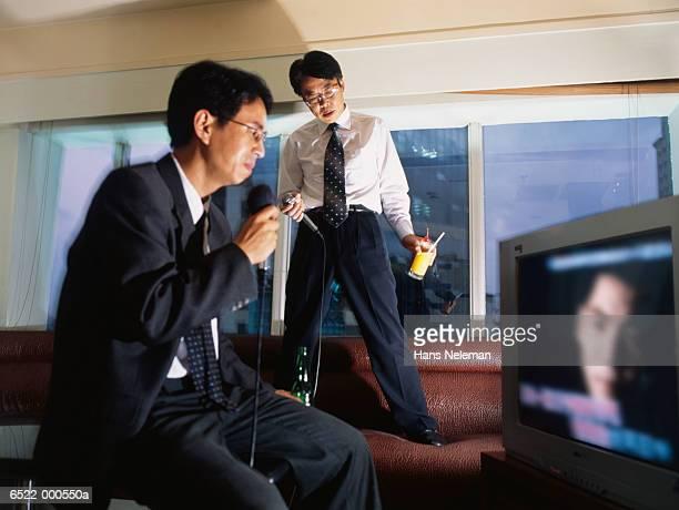 Businessmen Karaoke Singing
