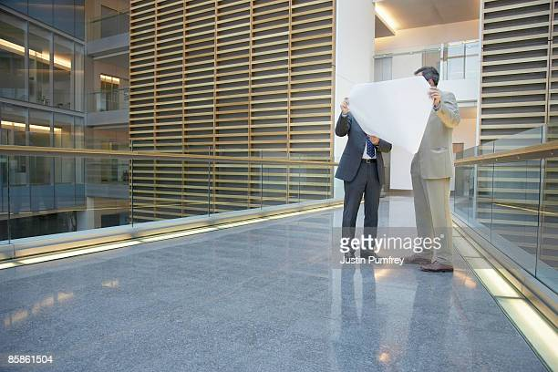 businessmen looking at architectural plans - obscured face stock pictures, royalty-free photos & images