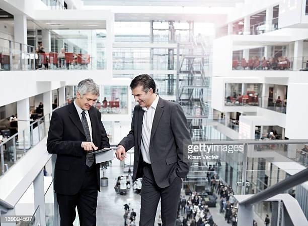 2 businessmen looking at tablet
