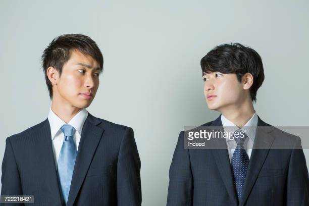 Businessmen looking face to face