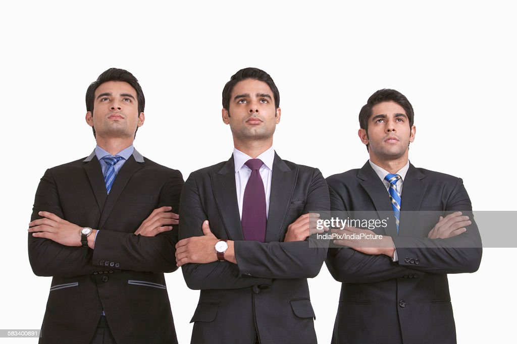Businessmen looking up : Stock Photo