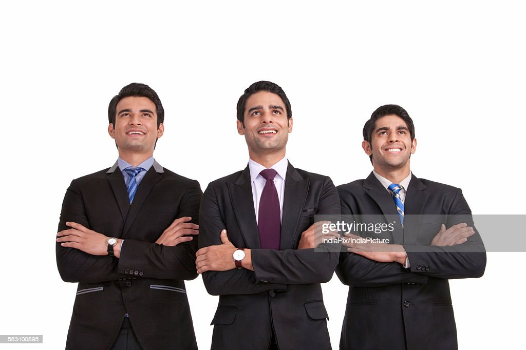 Businessmen looking up : Stock Photo