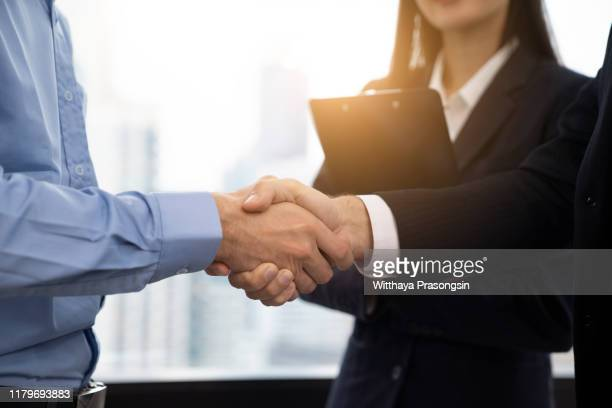 businessmen making handshake - morality stock pictures, royalty-free photos & images