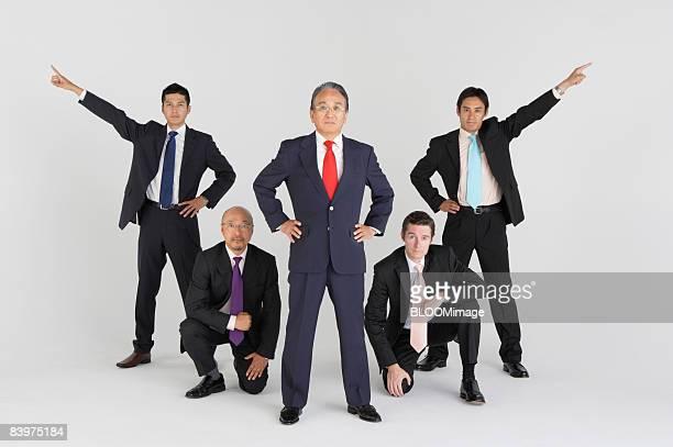 Businessmen making pose, studio shot