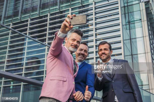 businessmen making selfie - zakelijke kleding stock pictures, royalty-free photos & images