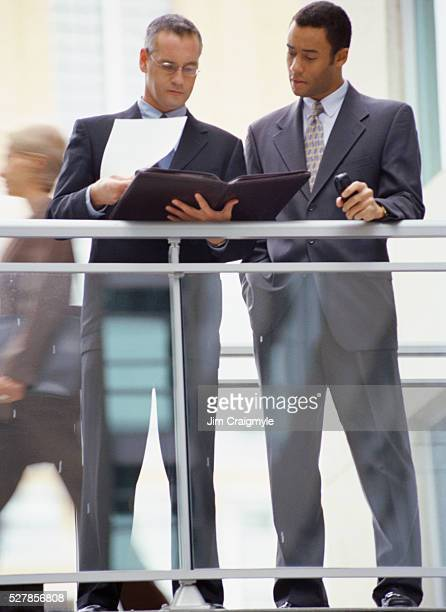 businessmen meeting at walkway - jim craigmyle stock pictures, royalty-free photos & images