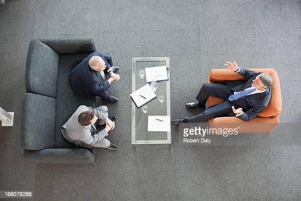 Businessmen meeting in lobby