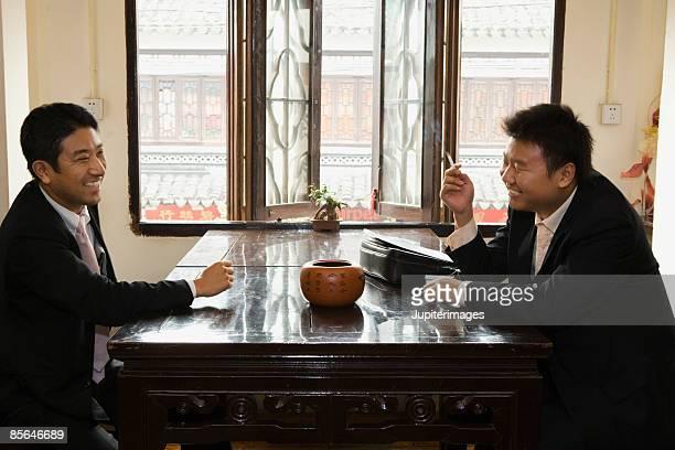 Businessmen meeting in teahouse