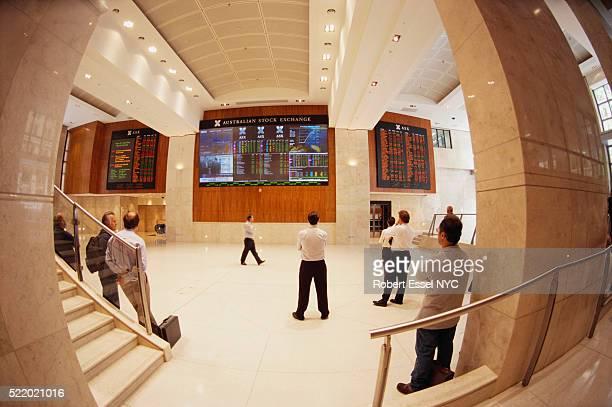 businessmen observing trading boards - sydney ストックフォトと画像