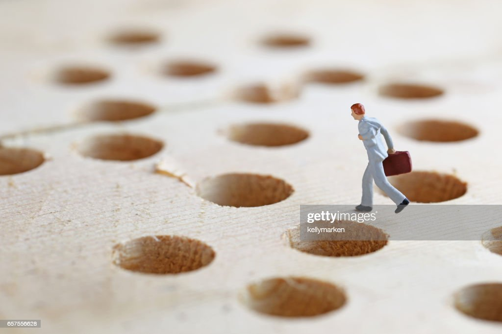 Businessmen of the pitfalls and miniature : Stock Photo