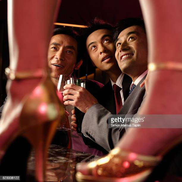 businessmen ogling woman - male stripper stock pictures, royalty-free photos & images