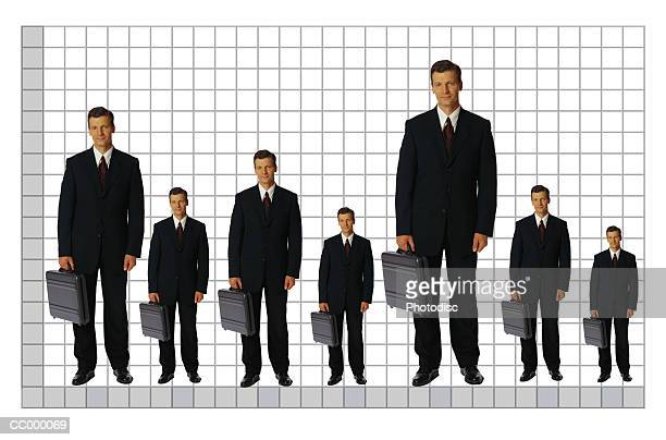 businessmen on a chart - tall person stock pictures, royalty-free photos & images