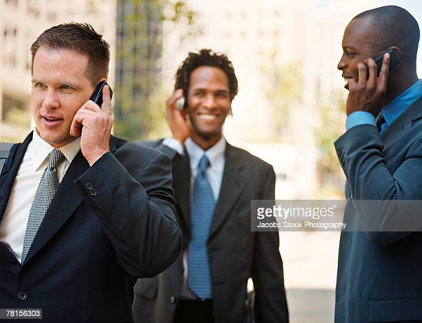 Businessmen on mobile phones