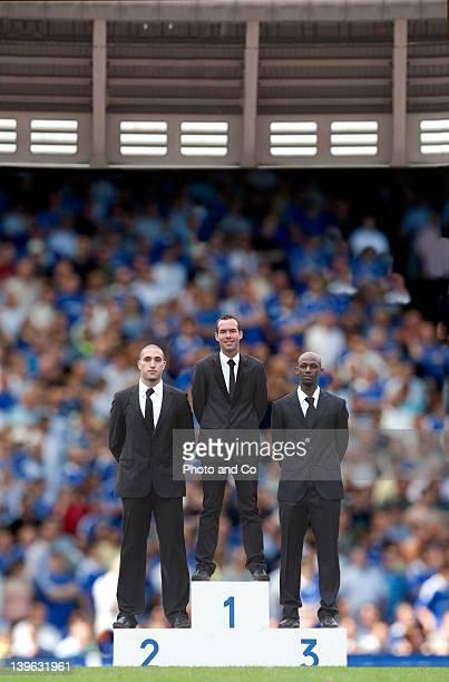 businessmen on podium, in sports stadium - winners podium ストックフォトと画像