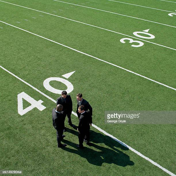 businessmen on sports field, elevated view - forty yard line stock pictures, royalty-free photos & images