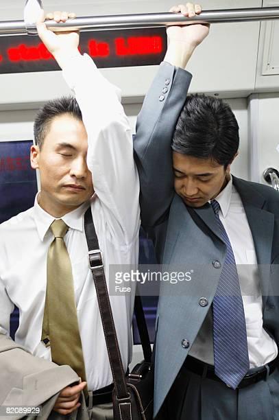 Businessmen on Subway Train