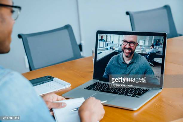 Businessmen on video conference
