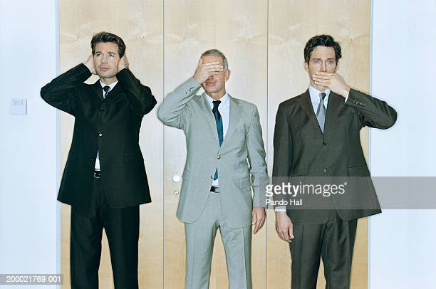 businessmen performing 'hear no evil, see no evil, speak no evil' - see no evil hear no evil speak no evil stock pictures, royalty-free photos & images