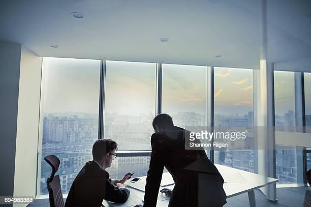 Businessmen planning in office meeting room